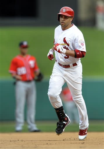 St. Louis Cardinals' Carlos Beltran rounds the bases after hitting his second home run of the baseball game in the fourth inning against the Washington Nationals Sunday, Sept. 30, 2012, in St. Louis. (AP Photo/Bill Boyce)