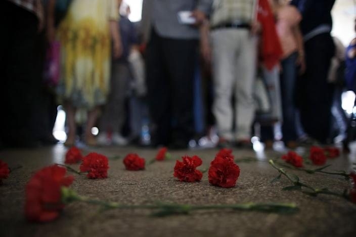 <p>Colleagues leave carnations for Erol Eskisoy and Ali Zulfukar Yorulmaz, two taxi drivers killed in Tuesday's blasts at the entrance of Ataturk Airport in Istanbul, Thursday, June 30, 2016. (AP Photo/Emrah Gurel) </p>