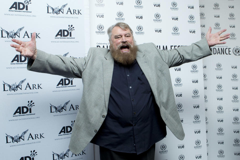 Actor and host Brian Blessed gestures as he arrives for the World Premiere of the documentary, Lion Ark, as part of the Raindance Film Festival, at a central London cinema, Tuesday, Oct. 1, 2013. (Photo by Joel Ryan/Invision/AP)