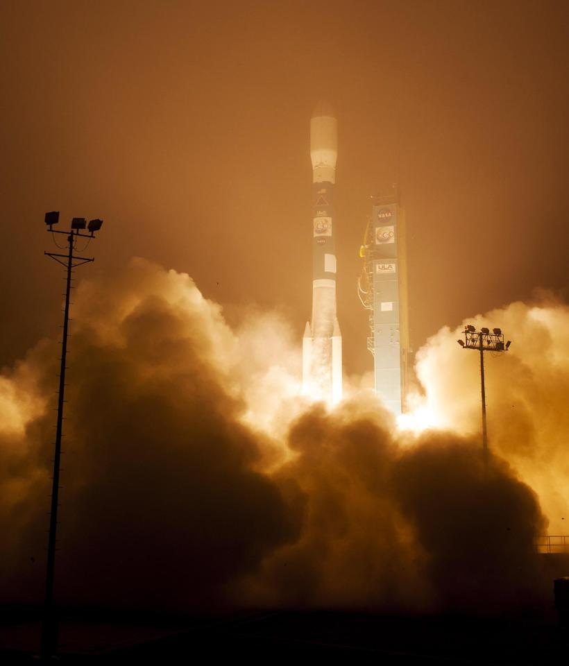 In this image released by NASA, a Delta 2 rocket with the Orbiting Carbon Observatory-2 satellite launches at Vandenberg Air Force Base, Calif., Wednesday morning, July 2, 2014. The goal of the $468 million mission, designed to last at least two years, is to study the processes behind how the environment absorbs carbon dioxide. (AP Photo/NASA, Bill Ingalls) MANDATORY CREDIT