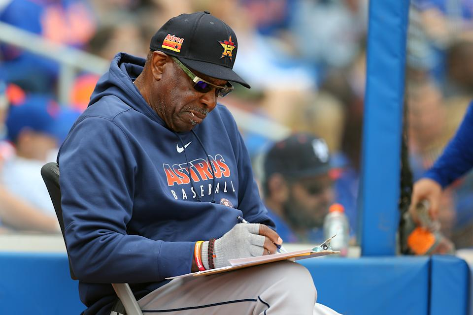 PORT ST. LUCIE, FL - MARCH 08: Manager Dusty Baker #12 of the Houston Astros checked his charts during the fifth inning of a spring training baseball game against the New York Mets at Clover Park on March 8, 2020 in Port St. Lucie, Florida. The Mets defeated the Astros 3-1. (Photo by Rich Schultz/Getty Images)