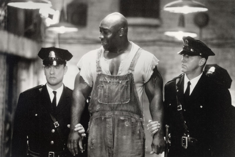 "This undated image provided by Warner Bros. shows Tom Hanks, left, Michael Clarke Duncan, center, and David Morse in ""The Green Mile."" Duncan has died at the age of 54 on Monday, Sept. 3, 2012 in a Los Angeles hospital after nearly two months of treatment following a July 13, 2012 heart attack, his fiancee, the Rev. Omarosa Manigault, said. (AP Photo/Warner Bros., Ralph Nelson)"