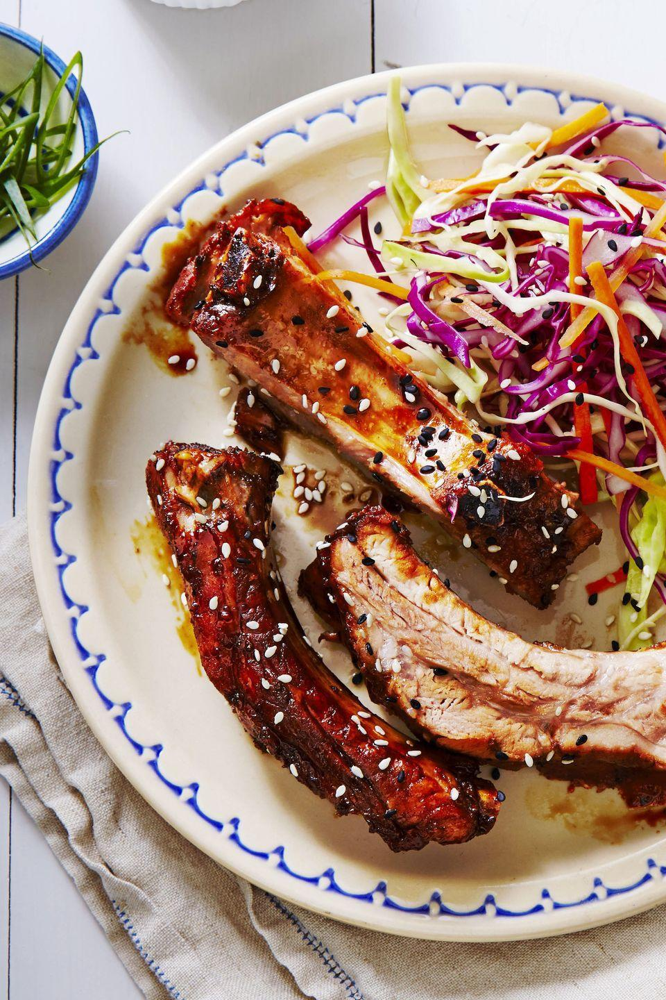 """<p>Simmer low-sodium soy sauce with balsamic vinegar and pressed garlic for a quick DIY teriyaki to baste on these tender slow cooker ribs.</p><p><em><a href=""""https://www.goodhousekeeping.com/food-recipes/easy/a34565/slow-cooked-teriyaki-ribs/"""" rel=""""nofollow noopener"""" target=""""_blank"""" data-ylk=""""slk:Get the recipe for Slow-Cooked Teriyaki Ribs »"""" class=""""link rapid-noclick-resp"""">Get the recipe for Slow-Cooked Teriyaki Ribs »</a></em> </p>"""