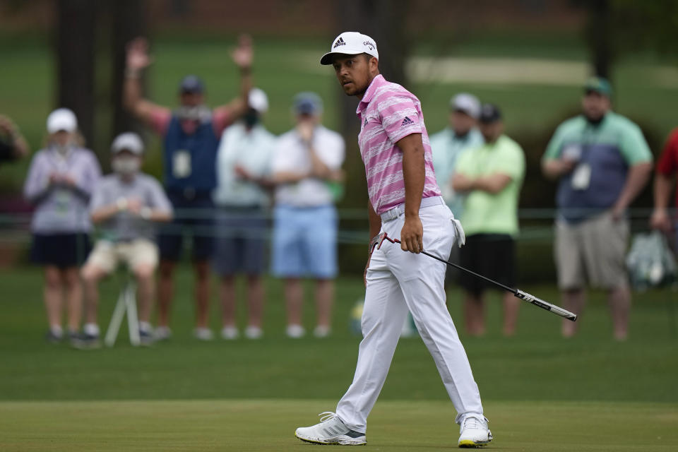 Xander Schauffele watches as his ball goes in for an eagle on the 15th hole during the third round of the Masters golf tournament on Saturday, April 10, 2021, in Augusta, Ga. (AP Photo/Matt Slocum)