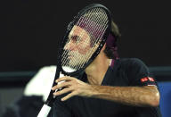 Switzerland's Roger Federer makes a backhand return to United States' Steve Johnson during their first round singles match at the Australian Open tennis championship in Melbourne, Australia, Monday, Jan. 20, 2020. (AP Photo/Lee Jin-man)