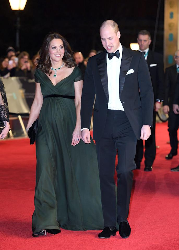 <p>The pregnant duchess housed her bump in a dark green Jenny Packham gown for the 2018 ceremony.</p>