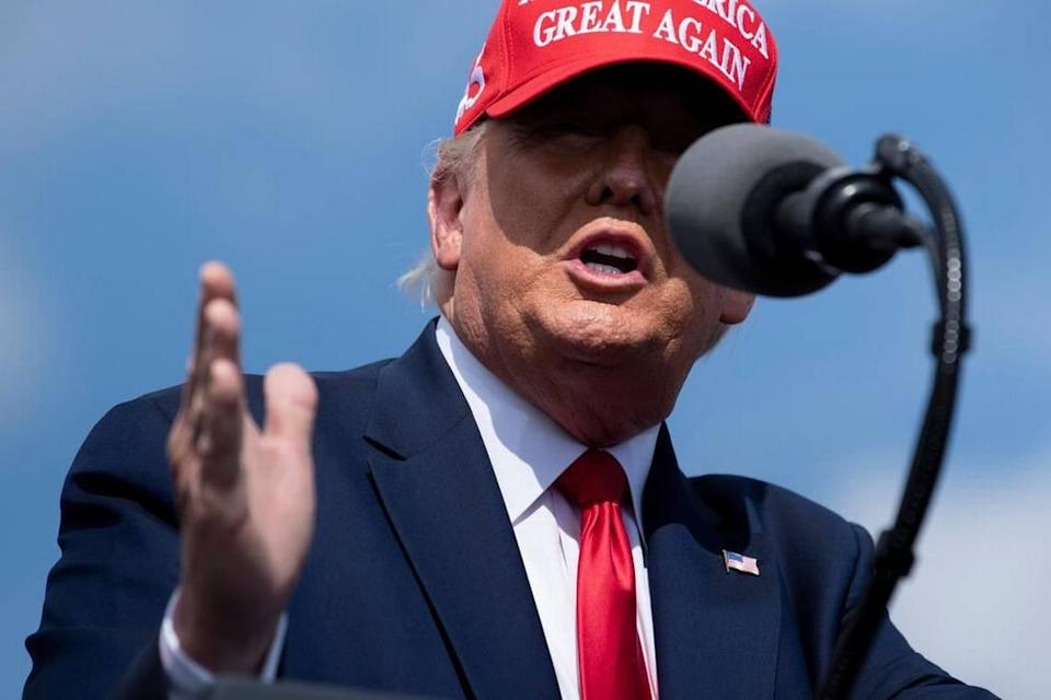 """US President Donald Trump speaks at a """"Make America Great Again"""" rally at Raymond James Stadium's parking lot on October 29, 2020, in Tampa, Florida. (Photo by Brendan Smialowski / AFP) (Photo by BRENDAN SMIALOWSKI/AFP via Getty Images)"""