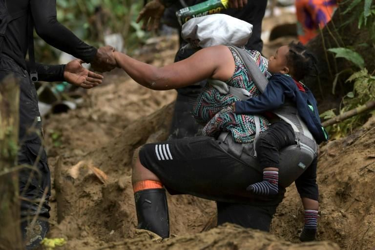 AFP joined a group of 500 Haitians for part of the journey through the perilous Darien Gap (AFP/Raul ARBOLEDA)