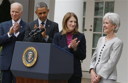 U.S. President Obama applauds after announcing Director of the Office of Management and Budget Burwell as his nominee to replace outgoing Health Secretary Sebelius, during a ceremony in the Rose Garden of the White House