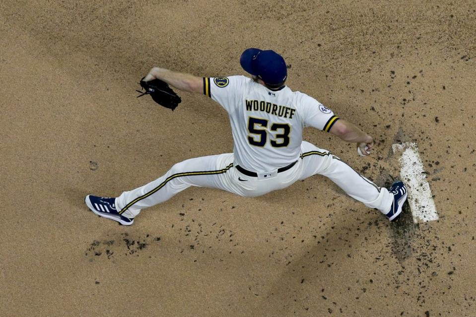 Milwaukee Brewers starting pitcher Brandon Woodruff throws during the first inning of a baseball game against the Chicago Cubs Tuesday, April 13, 2021, in Milwaukee. (AP Photo/Morry Gash)