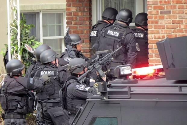 Swatting is the practice of making false reports to police in hopes of provoking an armed response. (Jim Staubitser/Newsday/Associated Press - image credit)