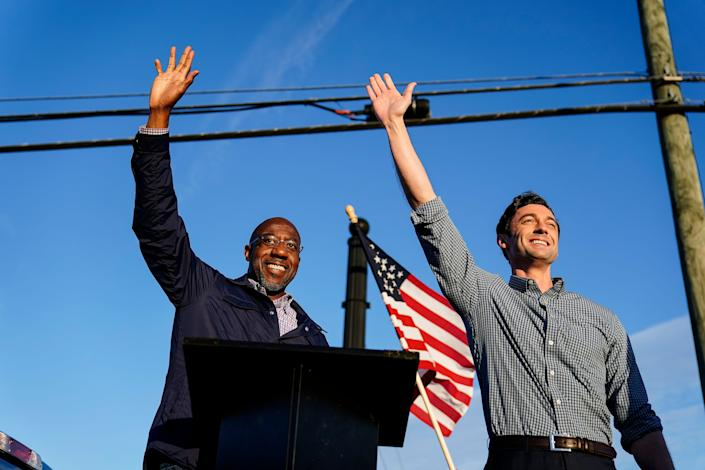 Democratic Senate candidates Raphael Warnock, left, and Jon Ossoff at a campaign rally in Marietta, Ga., on Nov. 15, 2020.