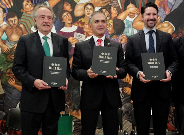 Decio de Maria Serrano, President of the Mexican Football Federation, Mexico City Mayor Miguel Angel Mancera and Yon de Luisa, Director of the joint bid by Mexico, United States and Canada for the FIFA World Cup 2026, pose for a photo in Mexico City, Mexico January 19, 2018. REUTERS/Daniel Becerril