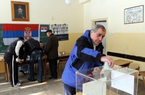 A Kosovo Serb casts his ballot in the village of Grabovac, northern Kosovo, on Tuesday. Serbs in north Kosovo rejected ethnic Albanian rule Wednesday in a controversial referendum seen as a slap in the face to efforts by Serbia and the EU to resolve differences over the territory