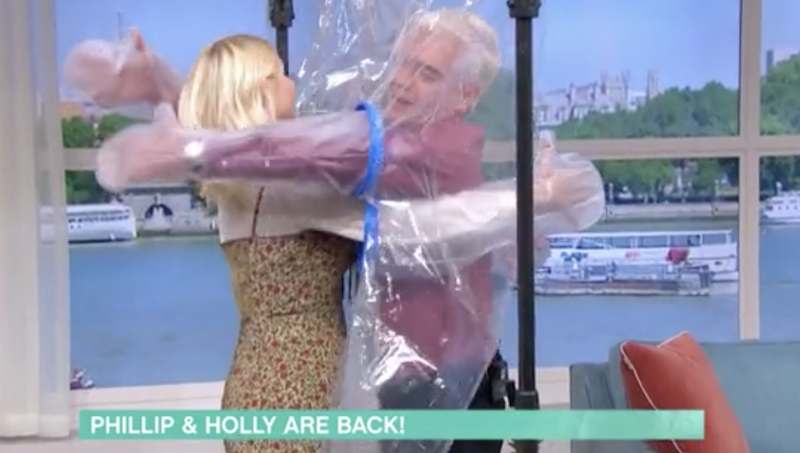 Phillip Schofield and Holly Willoughby were able to embrace with help from a 'cuddle curtain'. (ITV)
