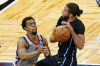 Washington Wizards guard Ish Smith, left, tries to stop Orlando Magic guard Michael Carter-Williams from shooting during the first half of an NBA basketball game Wednesday, April 7, 2021, in Orlando, Fla. (AP Photo/John Raoux)