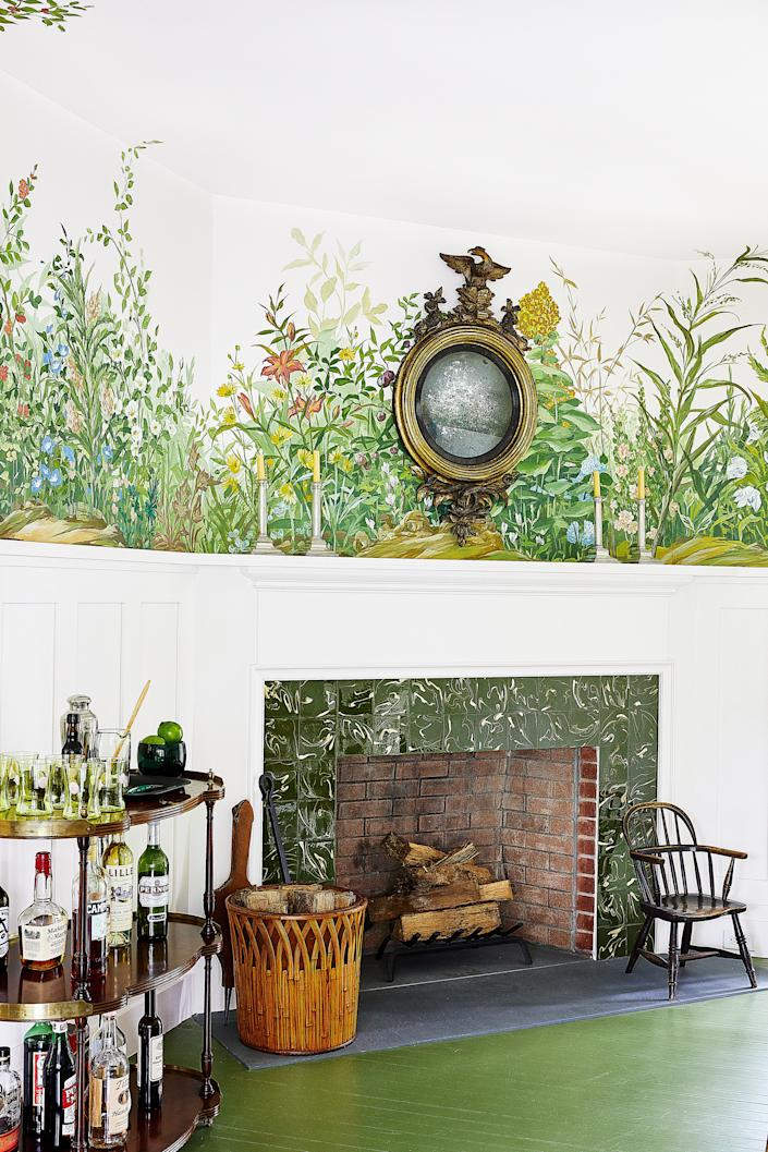 """<div class=""""caption""""> The dining room features a mural by <a href=""""https://www.bobchristiandecorativeart.com/"""" rel=""""nofollow noopener"""" target=""""_blank"""" data-ylk=""""slk:Bob Christian"""" class=""""link rapid-noclick-resp"""">Bob Christian</a>. 19th-century mirror and child's Windsor chair. </div>"""