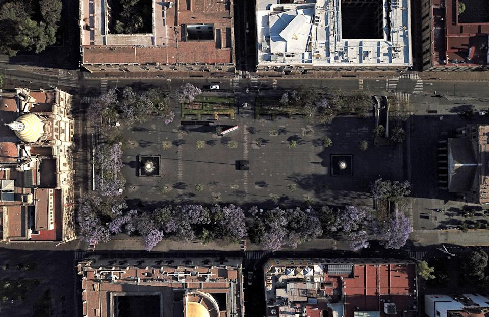 Aerial view of the empty Liberacion square in Guadalajara, Mexico, taken on March 25, 2020 at around eight am. - Central squares and parks in Latin America, which otherwise would be crowded, remained empty Wednesday at around eight am due to the lack of people circulating, as the world faces the new coronavirus pandemic. (Photo by ULISES RUIZ / AFP) (Photo by ULISES RUIZ/AFP via Getty Images)