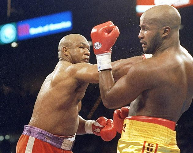 """3. George Foreman KO10 Michael Moorer, Nov. 5, 1994 – Foreman was 45 years old and trying to regain the heavyweight title. He was being badly outboxed by Moorer throughout the first nine rounds, when his legendary punching power came to the rescue. Foreman threw a jab and a straight right behind it, crumpling Moorer, as HBO broadcaster Jim Lampley shouted, """"It happened! It happened!"""" Foreman became, at 45, the sport's oldest heavyweight champion. (Photo credit: Getty)"""