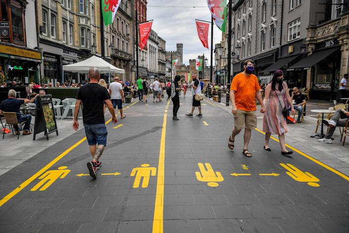 Yellow markings along the pedestrianised area of Cardiff city centre direct people to aid social distancing, as the First Minister for Wales, Mark Drakeford, has announced that from Monday up to 30 people can meet outside while maintaining social distancing in the latest easing of coronavirus measures in Wales.