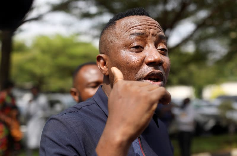 Nigerian human rights activist Omoyele Sowore walks near the Federal High Court in Abuja