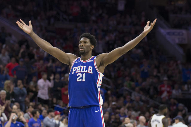 Joel Embiid fires up the crowd. (Getty)