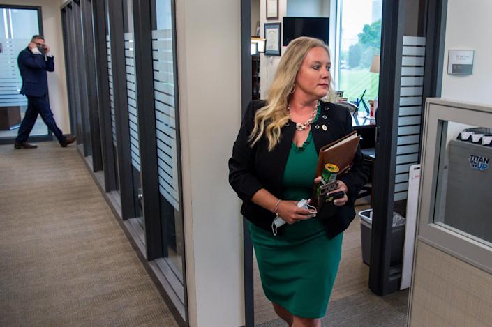 Tennessee Department of Health Commissioner Lisa Piercey leaves her office at the Department of Health office in Nashville, Tenn., to attend a meeting on Wednesday, April 28, 2021.