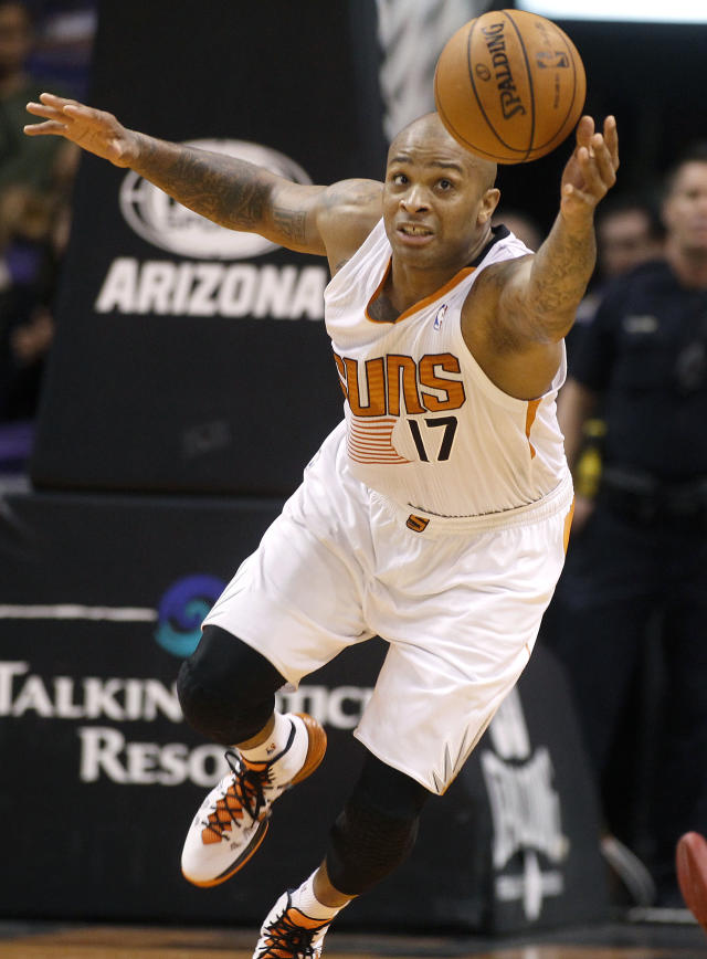 Phoenix Suns' P.J. Tucker (17) chases down a loose ball against the Toronto Raptors during the second half of an NBA basketball game Friday, Dec. 6, 2013, in Phoenix. The Suns defeated the Raptors 106-97. (AP Photo/Ralph Freso)