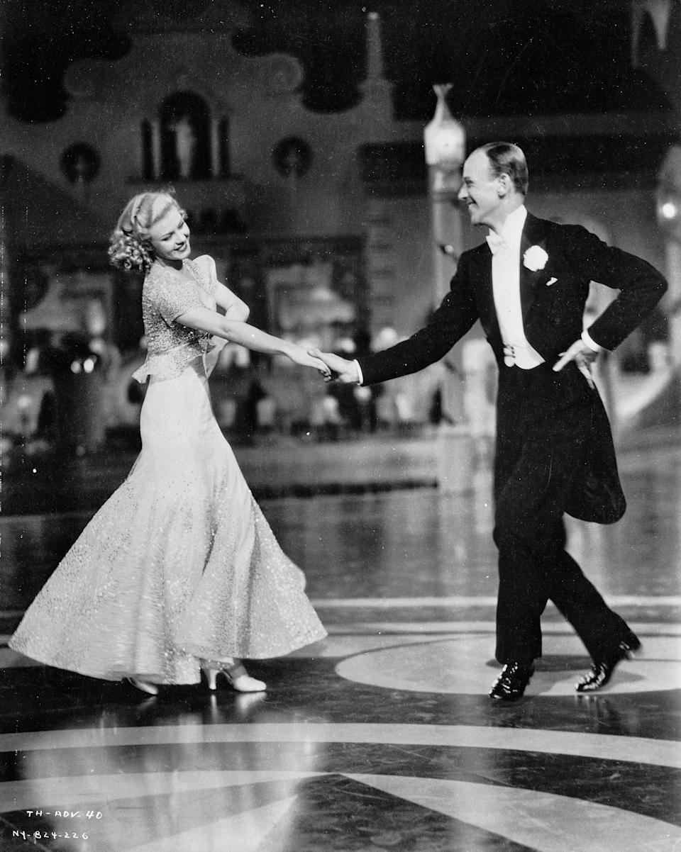 1935:  Ginger Rogers (Virginia McMath) (1911 - 1995) and Fred Astaire (Frederick Austerlitz) (1899 - 1987) as Dale Tremont and Jerry Travers respectively, dancing together in the RKO film,'Top Hat'. Director Mark Sandrich. Costumes by Bernard Newman.  (Photo via John Kobal Foundation/Getty Images)