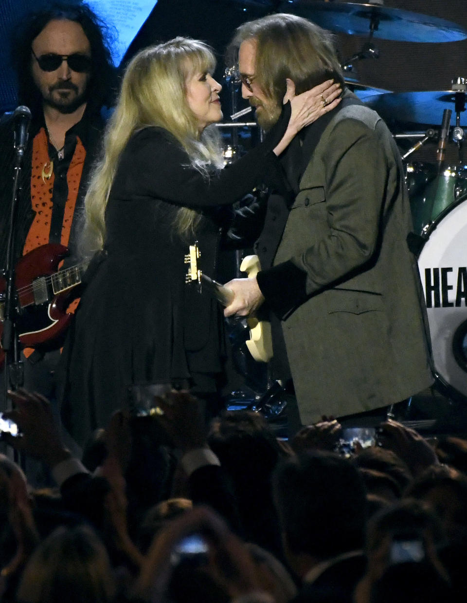 """FILE - Stevie Nicks, left, and honoree Tom Petty perform """"Stop Draggin' My Heart Around"""" at the MusiCares Person of the Year tribute in Los Angeles on Feb. 10, 2017. Just months before Petty died, the pair got together at the British Summer Time at Hyde Park in London to perform their 1981 hit """"Stop Draggin' My Heart Around."""" (Photo by Chris Pizzello/Invision/AP, File)"""