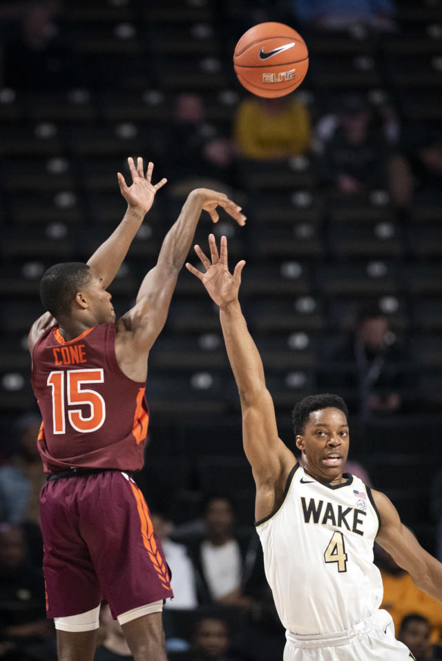 Virginia Tech guard Jalen Cone (15) shoots over defense from Wake Forest guard Jahcobi Neath (4) during an NCAA college basketball game Tuesday, Jan. 14, 2020 in Winston-Salem, N.C. (Andrew Dye/Winston-Salem Journal via AP)