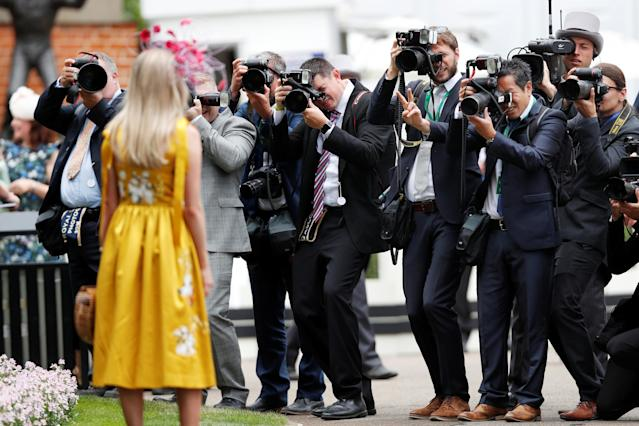 Horse Racing - Royal Ascot - Ascot Racecourse, Ascot, Britain - June 20, 2018 Photographers take a picture of a racegoer before the start Action Images via Reuters/Paul Childs