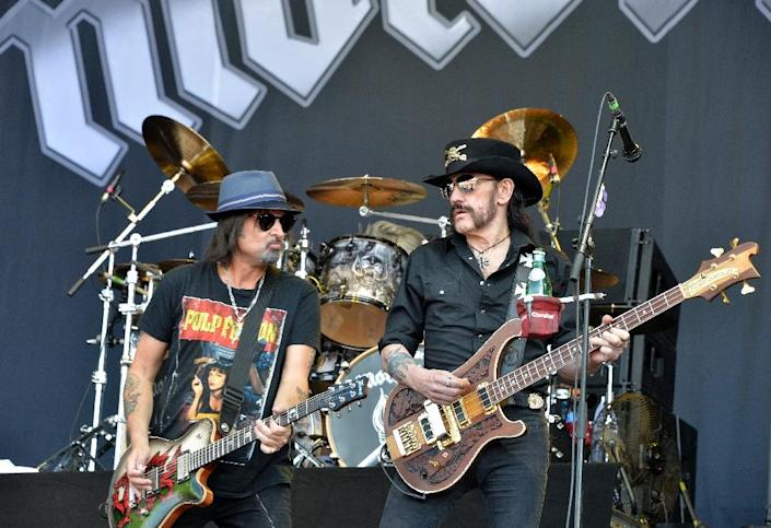 """Motorhead's Lemmy Kilmister (R) and Michael """"Wurzel"""" Burton (L) play at France's Hellfest, a hard-rock and metal festifal held near Nantes June 19, 2015; the act was among the latest to cancel Paris dates after the jihadist attacks of November 13 (AFP Photo/Georges Gobet)"""