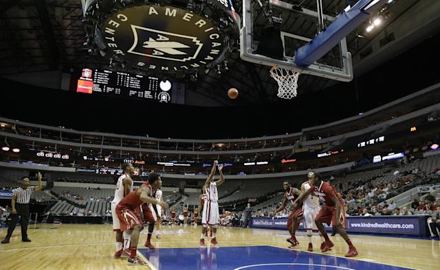 Oklahoma guard Isaiah Cousins (11) shoots a free throw during the first half of an NCAA college basketball game against Alabama in Dallas, Friday, Nov. 8, 2013. (AP Photo/LM Otero)