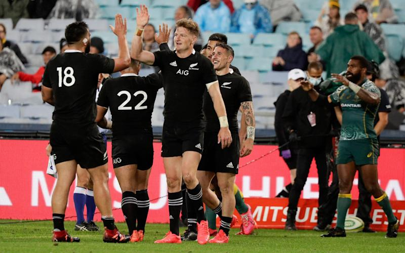 New Zealand players celebrate after winning their Bledisloe rugby test 43-5 against the Wallabies - AP