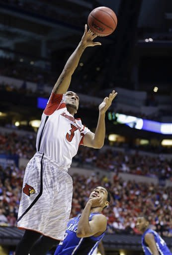 Louisville guard Peyton Siva (3) goes up with a shot against Duke guard Quinn Cook (2) during the first half of the Midwest Regional final in the NCAA college basketball tournament, Sunday, March 31, 2013, in Indianapolis. (AP Photo/Michael Conroy)