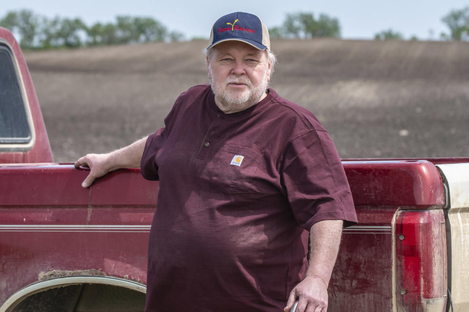 In this photo provided by Farm Rescue, Paul Ivesda watches as volunteers plant crops on his farm June 3, 2020 in Edmore, N.D. The wet spring offered only a tiny window for planting, so when Ivesdal fell ill to a coronavirus infection he knew the timing couldn't be worse. Thanks to Farm Rescue, Ivesdal got his crop in even as he was rushed to a hospital and spend eight days on a ventilator. The nonprofit organization's help meant that although Ivesdal spent a summer in rehabilitation to recover his walking ability and even now tires more easily, he'll be able to keep farming. (Dan Erdmann/Farm Rescue via AP)