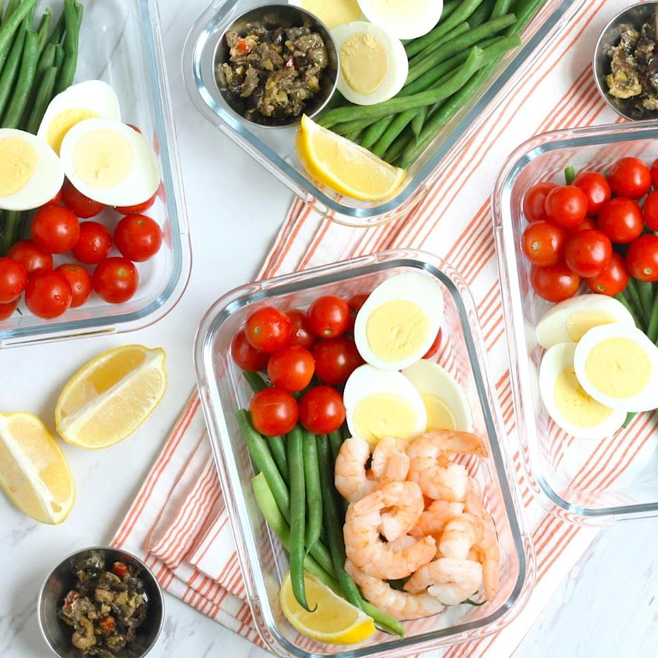 "<p>This low-carb meal-prep version of the classic composed salad comes together in about 10 minutes thanks to a handful of shortcut ingredients, like pretrimmed green beans and prepared olive tapenade. With a whopping 41 grams of protein per serving, these bowls will keep hunger at bay all afternoon. To switch things up, feel free to swap in canned tuna or leftover roasted salmon for the shrimp. We love going to Trader Joe's for fast shortcut ingredients--see Tip (below) for our product recommendations. <a href=""http://www.eatingwell.com/recipe/277764/shrimp-nicoise-meal-prep-bowls/"" rel=""nofollow noopener"" target=""_blank"" data-ylk=""slk:View recipe"" class=""link rapid-noclick-resp""> View recipe </a></p>"