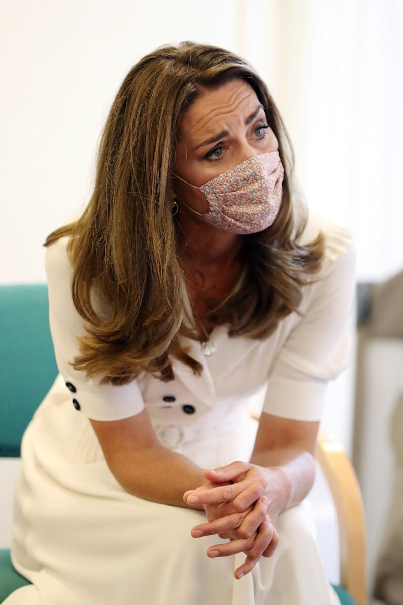 Catherine, Duchess of Cambridge, wearing a face mask, talks to the family of Ali Wartty, Sahara Hamawandy and their triplets San, Shan and Laveen, who got supported by Baby Basics, during a visit to Baby Basic UK & Baby Basics Sheffield on August 04, 2020 in Sheffield, England. Baby Basics is a volunteer project supporting families in need struggling to provide for their newborns.