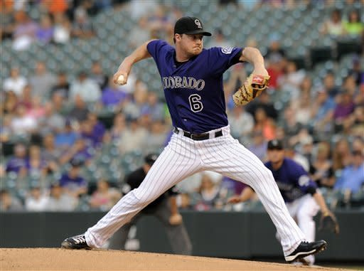 Colorado Rockies starting pitcher Alex White throws during the first inning of a baseball game against the San Francisco Giants in Denver on Monday, Sept. 10, 2012. (AP Photo/Chris Schneider)