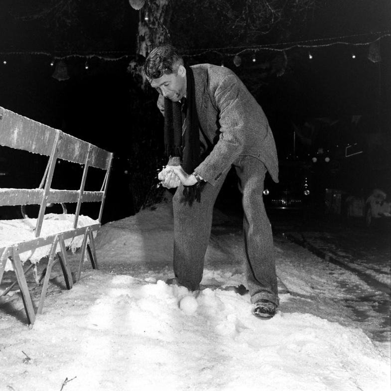 Jimmy Stewart makes a 'snowball' on the set.