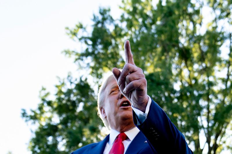 President Donald Trump takes a question from a reporter before boarding Marine One on the South Lawn of the White House in Washington, Monday, Sept. 21, 2020, for a short trip to Andrews Air Force Base, Md., and then on to Ohio for rallies. (AP Photo/Andrew Harnik) (Photo: ASSOCIATED PRESS)