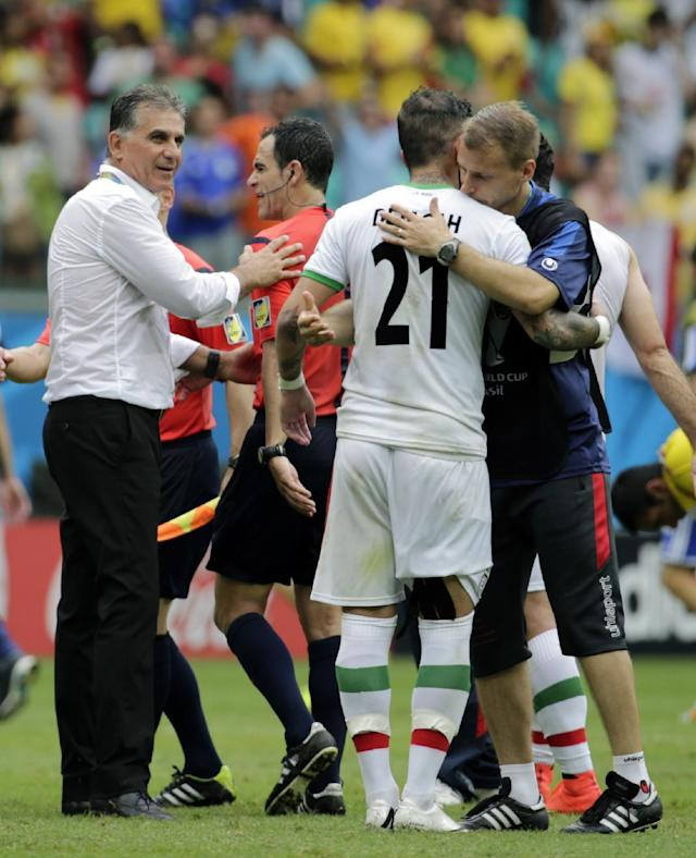 Iran's head coach Carlos Queiroz, left, reacts after the group F World Cup soccer match between Bosnia and Iran at the Arena Fonte Nova in Salvador, Brazil, Wednesday, June 25, 2014. Bosnia won the match 3-1. (AP Photo/Fernando Llano)