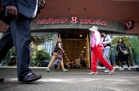 People walk past a store of yogawear retailer Lululemon Athletica in downtown Vancouver