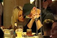 The pair looked completely loved-up as they enjoyed a family dinner together on Saturday night.