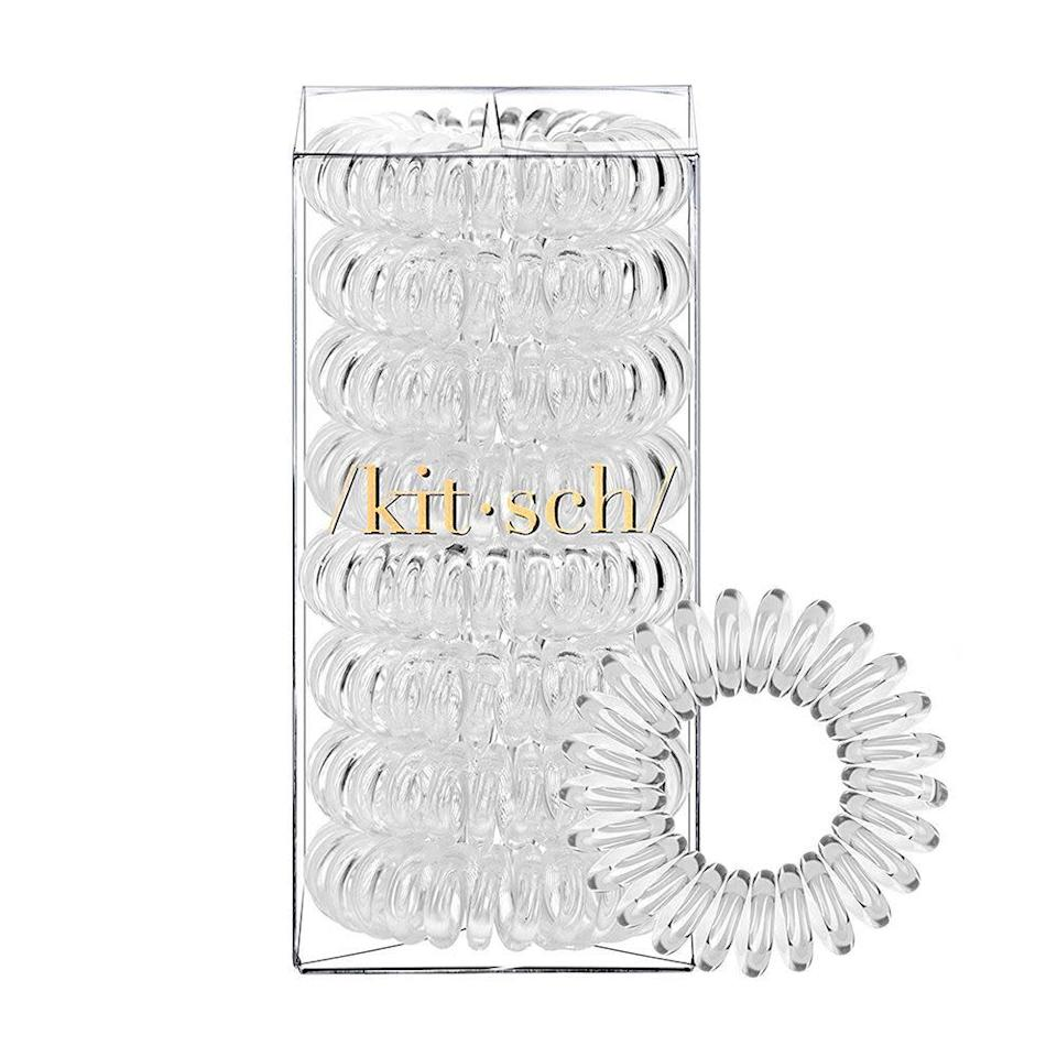"""<p><strong>Kitsch</strong></p><p>amazon.com</p><p><strong>$7.99</strong></p><p><a href=""""https://www.amazon.com/dp/B07BYRG1G5?tag=syn-yahoo-20&ascsubtag=%5Bartid%7C10058.g.33762832%5Bsrc%7Cyahoo-us"""" rel=""""nofollow noopener"""" target=""""_blank"""" data-ylk=""""slk:SHOP IT"""" class=""""link rapid-noclick-resp"""">SHOP IT</a></p><p>Elastic hair ties are out, and these coiled rings are in. Not only do they look way cuter on your wrist than a rubber band, but the stretchy plastic is way less damaging to your strands. </p>"""