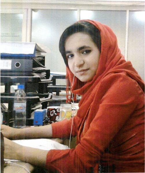 This file image provided by Interpol shows an undated photo of Shokofa Salehi.The young woman worked for three years at the Afghan bank, officials say. Then one day she vanished. As did $1.1 million. Afghan authorities have been scrambling to track down the suspected thief and at least nine other alleged accomplices, and an international arrest warrant has been issued. (AP Photo/Interpol, File)