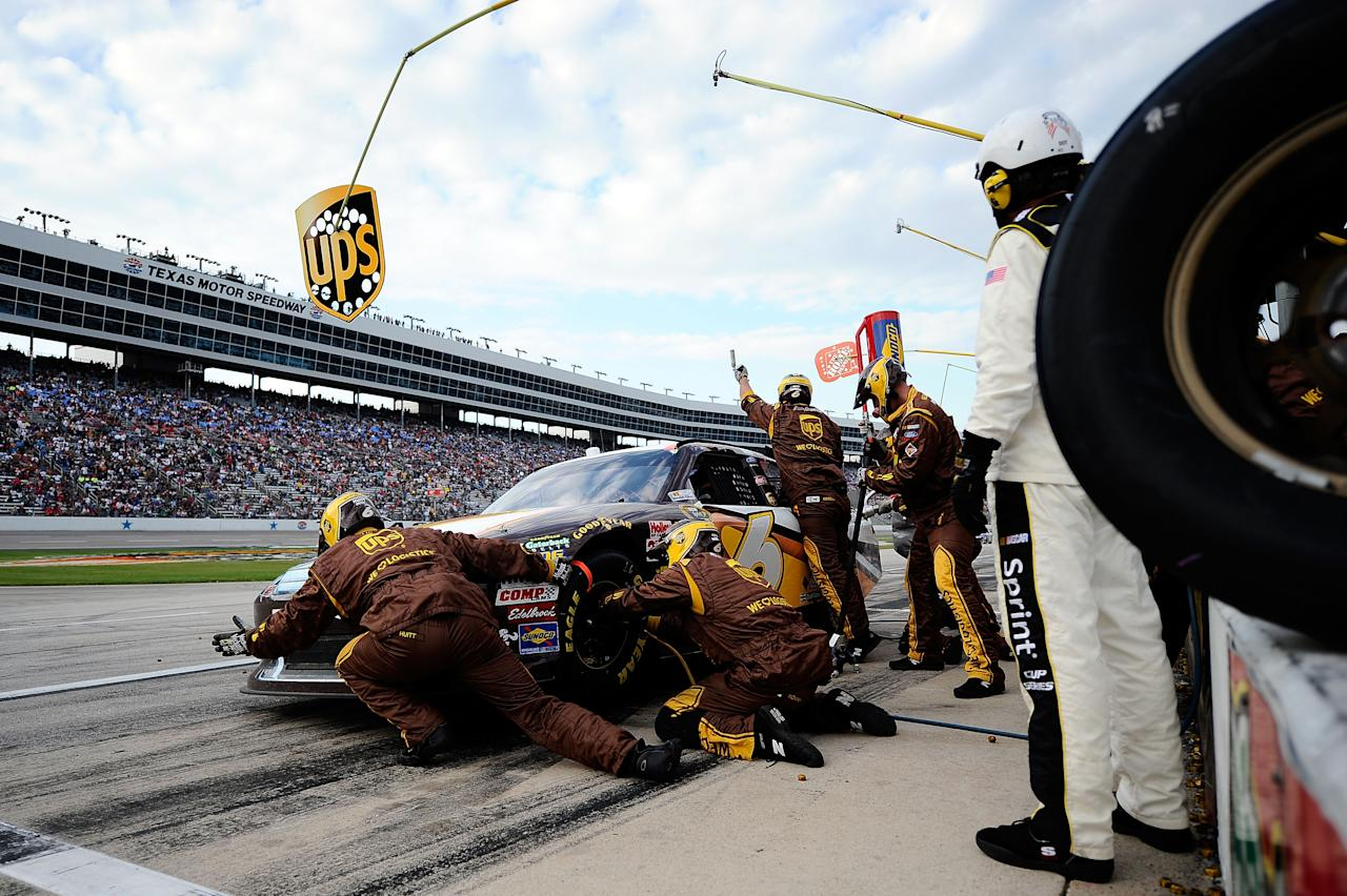 FORT WORTH, TX - NOVEMBER 06:  David Ragan, driver of the #6 UPS My Choice Ford, pits during the NASCAR Sprint Cup Series AAA Texas 500 at Texas Motor Speedway on November 6, 2011 in Fort Worth, Texas.  (Photo by Jared C. Tilton/Getty Images for NASCAR)