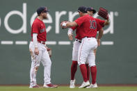 Boston Red Sox's Alex Verdugo, left, Enrique Hernandez, behind right, and Hunter Renfroe (10) celebrate after beating the New York Yankees 5-4 in a baseball game, Sunday, July 25, 2021, in Boston. (AP Photo/Steven Senne)