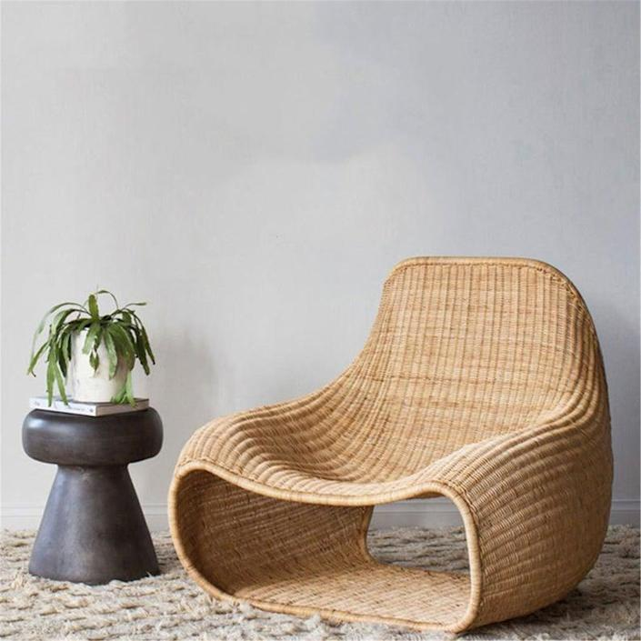 """One more rattan chair for good measure, this swoopy option by JerGreenwal has a little storage station built in the underside. $139, Etsy. <a href=""""https://www.etsy.com/listing/965112307/free-shipping-outdoor-indoor-rattan?ga_order=most_relevant&ga_search_type=all&ga_view_type=gallery&ga_search_query=patio+furniture&ref=sr_gallery-1-3&organic_search_click=1&frs=1"""" rel=""""nofollow noopener"""" target=""""_blank"""" data-ylk=""""slk:Get it now!"""" class=""""link rapid-noclick-resp"""">Get it now!</a>"""